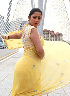 Actress Charmi in Yellow Designer Saree and Fancy blouse back design