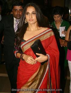 Vidya Balan in Red saree with big zari border paired with three fourth sleeves designer sari blouse