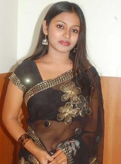 South Indian Actress in Black Transparent Saree