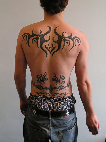 Back tribal tattoos for men can be one of the sexiest tattoo man can get.