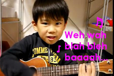 Talent abounding.  Maybe not his English, he sure does have mad ukelele skillz.