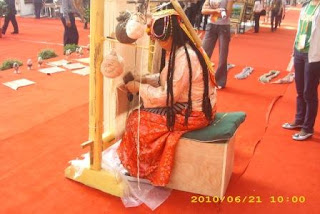 Chinese artisans at the expo demonstrating the art of creating a hand woven rug