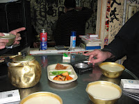 table top in makkuli bar-note well-used bowls
