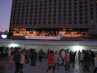 light display atop portico of Seoul Plaza Hotel