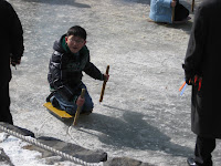 Namsangol Village, boy on frozen pond
