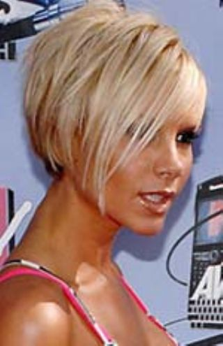 Trendy black medium blunt bob hairstyle with bangs.