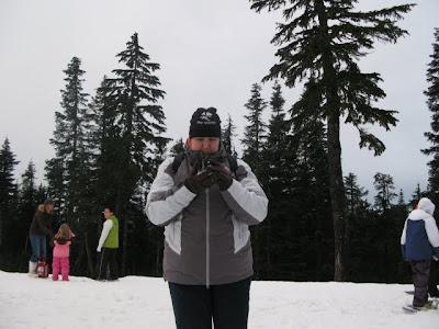 paula inspecting the snow