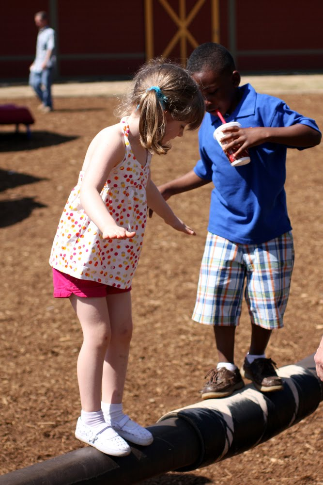 black and white children playing together