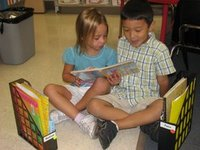 [Boy+and+Girl+Shared+Reading+from+Book+Bins]