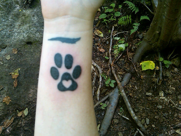 to get a tribute tattoo of a scaled down version of his paw print with a
