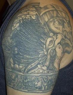 Aztec Themed Upper Arm Tattoo