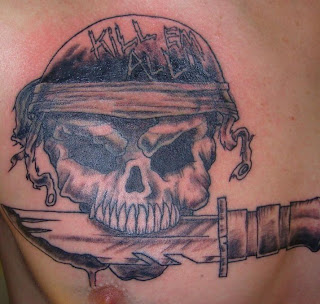 Black Ink Skull Tattoo Design on Chest