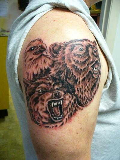Wolf Tattoo On Arms With Bear And Eagle Tattoo