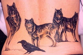 Lower back wolf Tattoo design with Crow