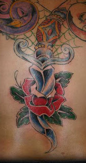 Tattoo of a Rose and Dagger - Spider Web Tattoo