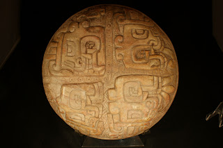 Chavin shamanic steatite stone plate with depiction of staff god for ritual herbs