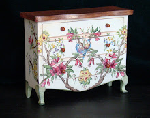 Country chest  of drawers painted with birds and flowers