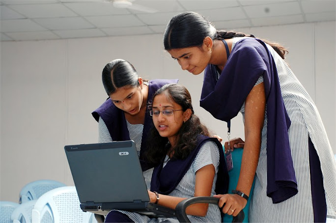 students operating laptop