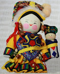 boneca da felicidade