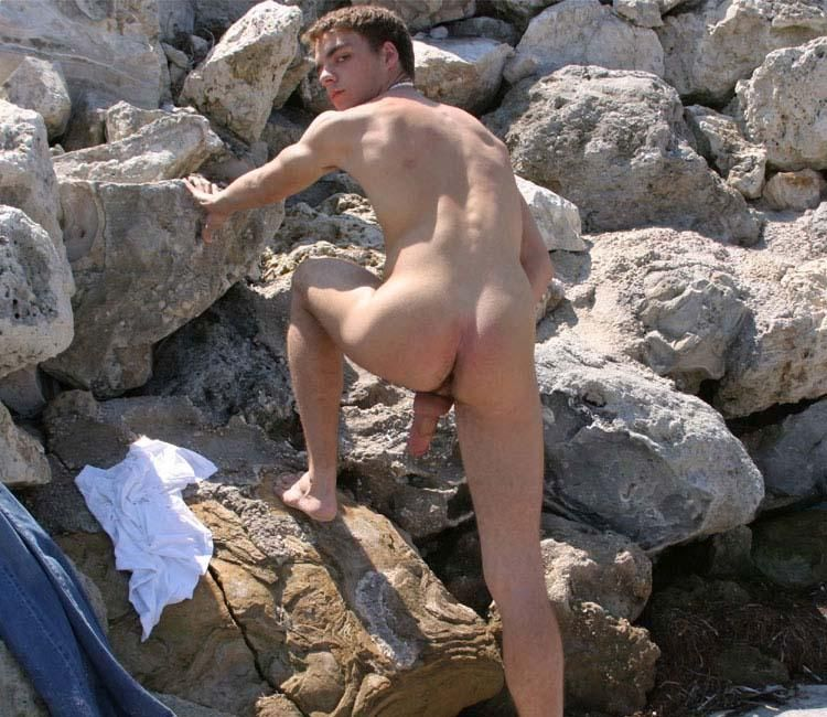 naked people climbing rocks