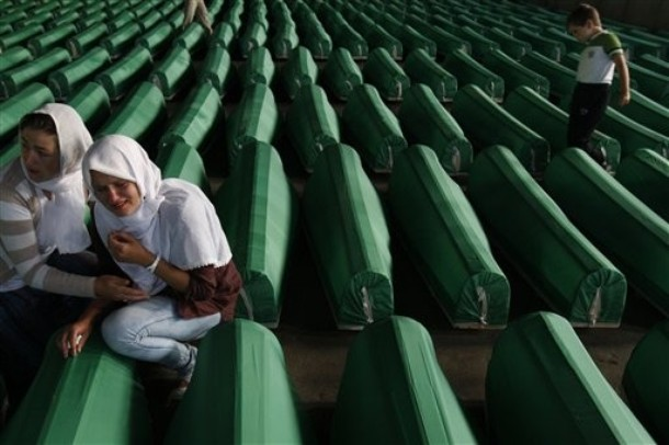other among coffins of Srebrenica victims displayed at the Srebrenica ...