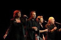 Photo of Manhattan Transfer vocal quartet singing