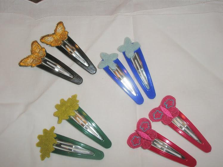 Ganchos coloridos com apliques