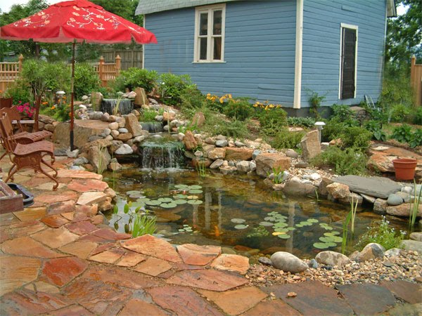 Small property waterfall and pond