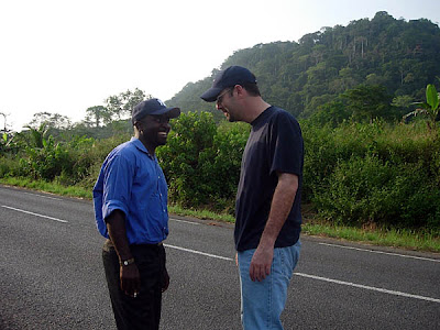 Mr. Boh and me goofing around along the highway from Yaounde to Kribi