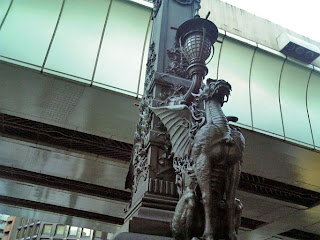 figure in bronze on nihonbashi bridge