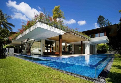 House With Outdoor Patios, Green Roof And Clear Sided Pool