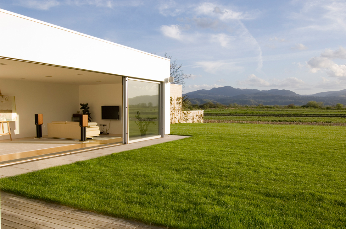 Beautiful houses sliding glass walls of the house in slovenia for Glass wall designs for houses