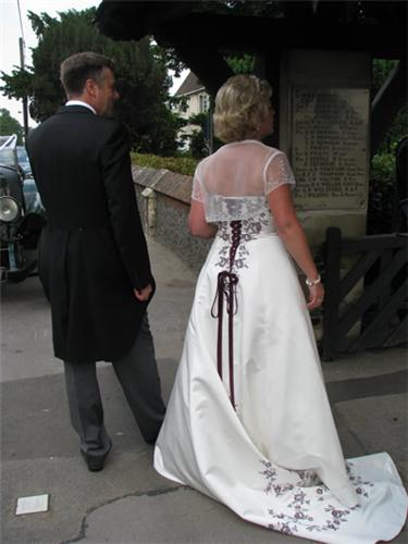 An absolutely stunning Rosetta Nicolini wedding dress ivory in colour with