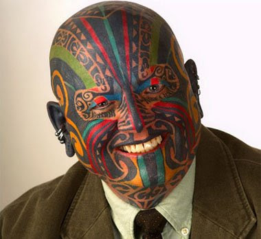 Man with a tattooed face. tattoo factory 2. tattoo on bald head tattoo