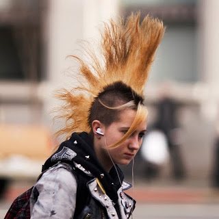 Punk hairstyles are bizarre and colorful. A Mohawk hairstyle is popular with