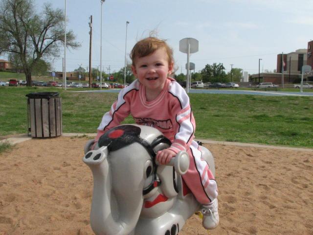 Kaydence Riding a elephant.