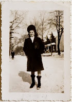 vintage photo from 1944 of a young woman in coat, hat and boots of the period