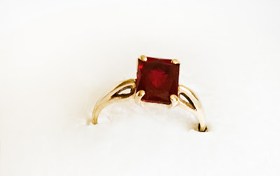 14 karat gold birthstone ring with square natural garnet
