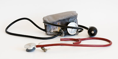 a standard blood pressure cuff and stethoscope