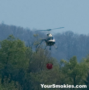 a light helicopter dropped loads of water taken from a pond in Wears Valley