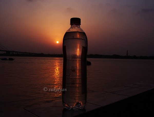Reflection of sunset beside Ganges at Kolkata - travel photography by Sukalyan Chakraborty
