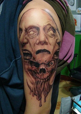 A skull tattoo on the arm with four faces