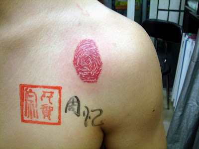 Fingerprint tattoo below the shoulder