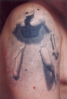 Stone statue tattoo design on the arm