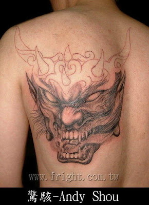Mr. Evil Tattoo for Free Design Tattooed in the Back
