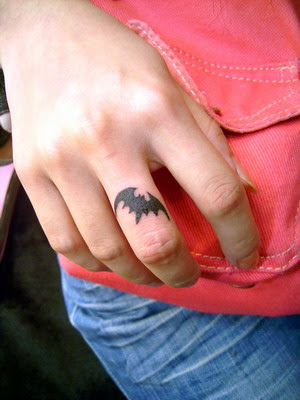 This free tattoo design is a very small cute bat on the finger.