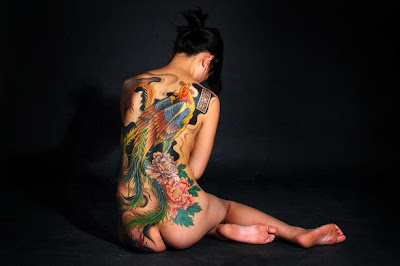 Full back phoenix peacock tattoo for a girl, another angle