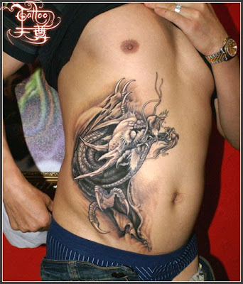 Chinese dragon tattoo on the hip
