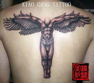a muscular angel tattoo on the back
