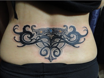 totem-like lower back tattoo
